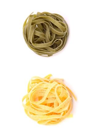 tagliatelle: Tagliatelle paglia e fieno homemade tipycal italian pasta close-up on the white background