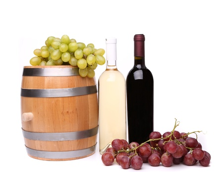 barrel and bottles of wine and ripe grapes on barrel