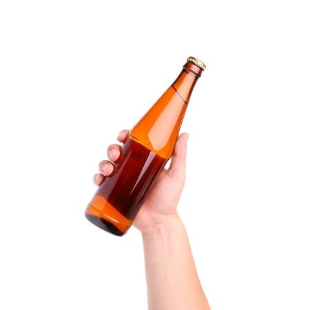 bottiglia di vetro in mano isolato su sfondo bianco Archivio Fotografico