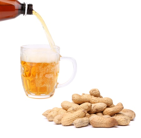 Peanuts, stream, glass of beer photo