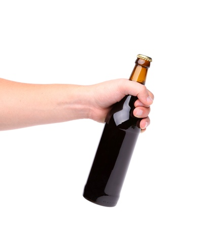 Beer bottle in the hand isolated on white photo