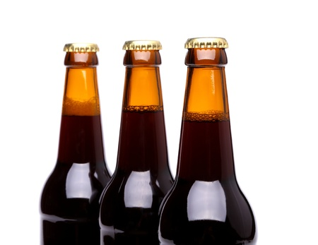 bottleneck: Three bottles of beer isolated on a white bacground
