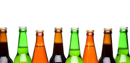 Row from beer bottles. Isolated on white background photo