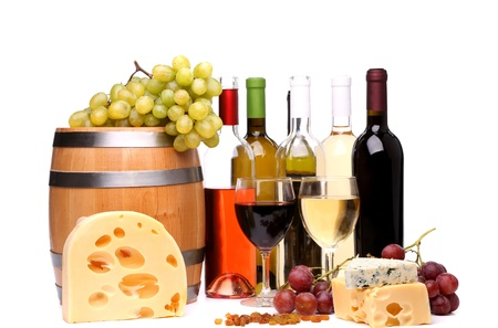 barrel, cheeses, bottles and glasses of wine and ripe grapes photo