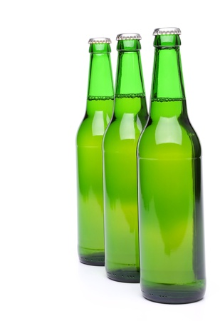 Row from beer bottles  Isolated on white background  photo