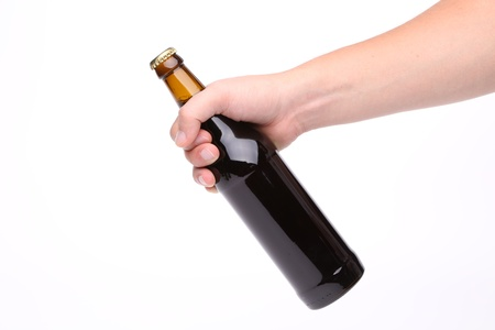 Hand with beer bottle isolated on a white background photo