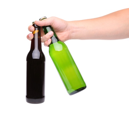 green glass bottle: Hand with two bottle of beer on a white background