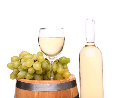 barrel, ripe grapes, glass and bottle of wine photo