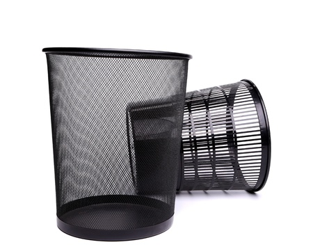 A metal trash can and a top plastic trash can on a white background. photo