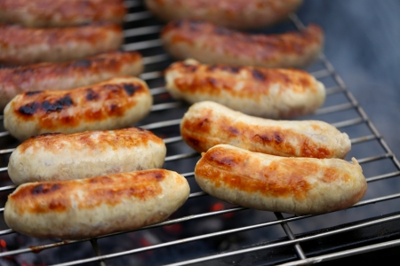 nicely: Nicely grilled sausages on a whole background