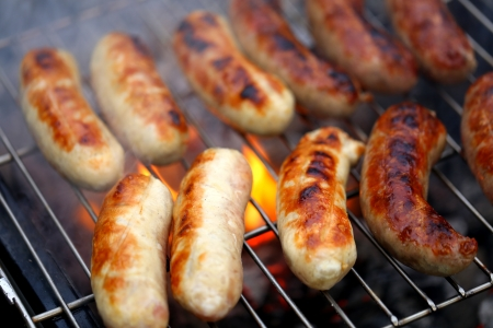 Nicely grilled sausages on a whole background