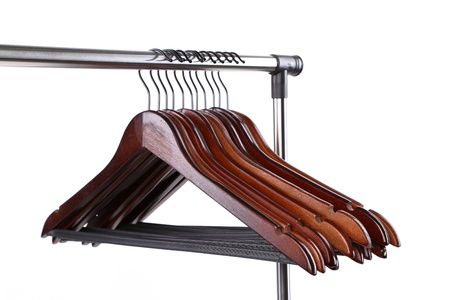 wooden clothes hangers on a white background photo