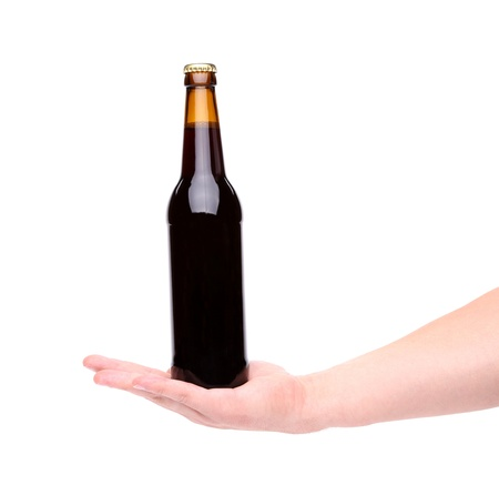 pilsner glass: Bottle of beer on a hand. White background.
