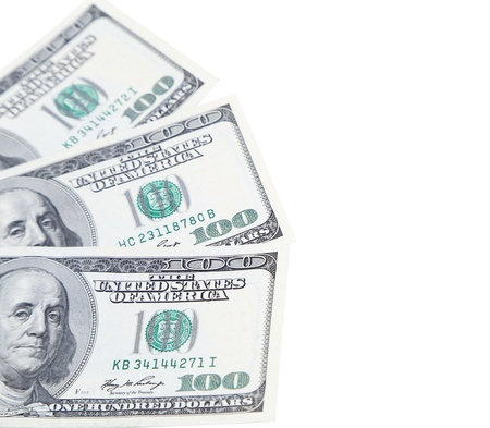 Three 100 dollars greenbacks are located left on a white background photo