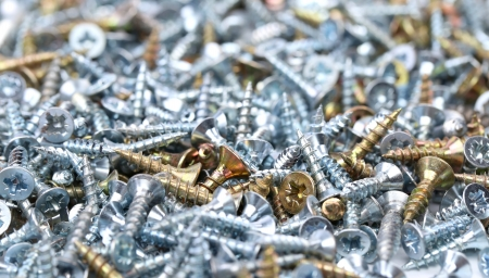 zinked: Zinked and anodized screws on a whole background