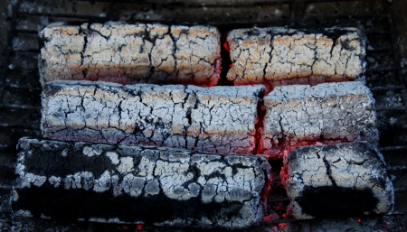briquettes: glowing embers from wooden briquettes  background  texture  Stock Photo