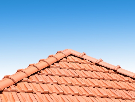 clinker tile: red peaked roof are located on a blue sky