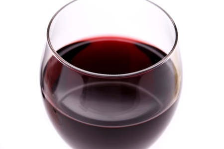 aligote: Glass of red wine. Close-up. White background. Stock Photo