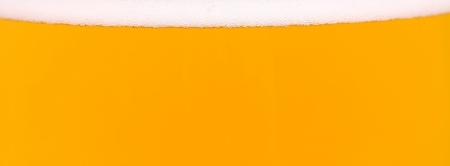 Light beer background. Is a thin strip of foam on top photo