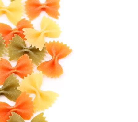 background of the farfalle pasta three colors close-up.