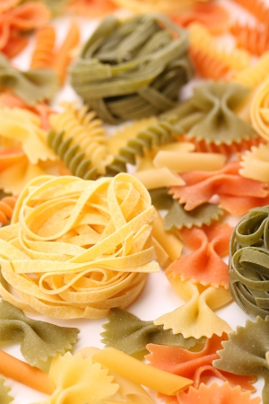 different pasta in three colors. Close-up. Background.