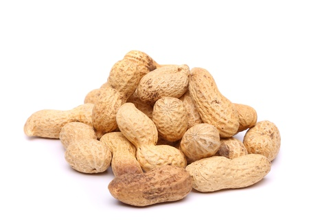 goober: Handful of peanuts on a white background