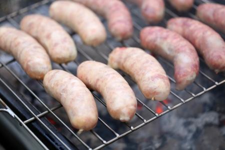 Fresh sausage grilling on a barbecue grill  photo