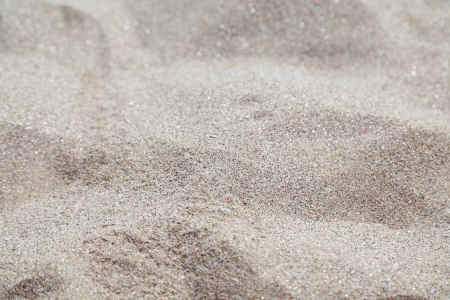 Sand background  Uneven gray sand close up  photo