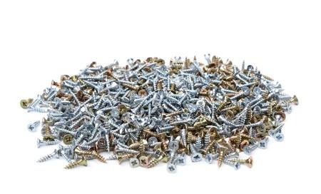 anodized: Tornillos de galvanizado y anodizado sobre un fondo blanco. Textura.