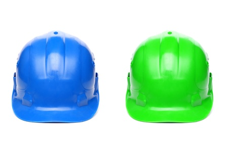 hard hats: Blue and green hard hats isolated on a white background