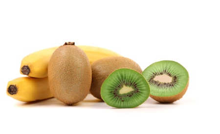 Bananas. Kiwi fruits and slice. Close-up. White background. photo