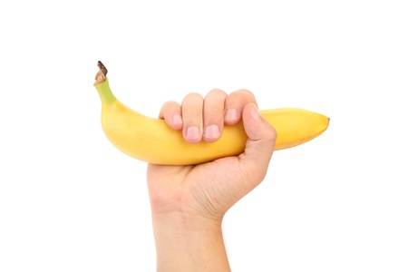 Hand hold banana. fruit. isolated. white background. photo