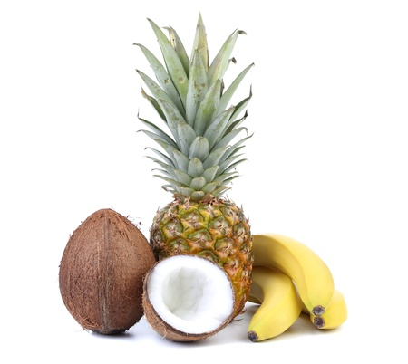Coconut, banana and pineapple isolated on white photo