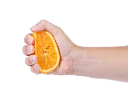 squeezing: Hand squeeze ripe juicy orange. White background.