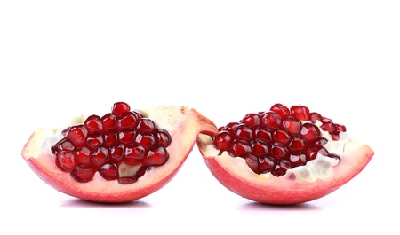 Pomegranate slices isolated on a white backgrount photo