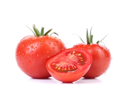 Two red ripe tomatoes and slice isolated photo