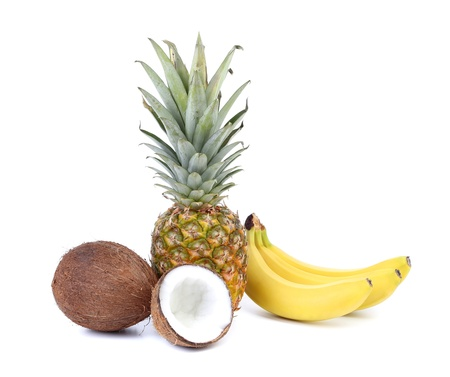 Coconut, banana and pineapple isolated on a white background photo