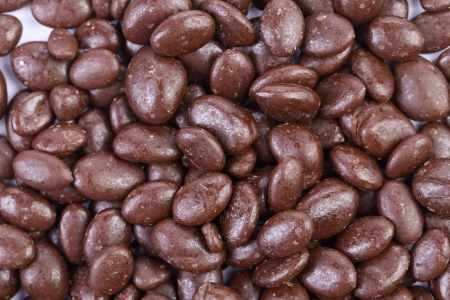 dragee: Dark brown dragee, in chocolate covered. Whole background.
