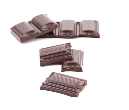 morsel: Tasty morsel of dark chocolate. White background.
