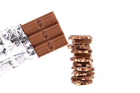 morsel: Bar of chocolate in foil and tasty morsel. White background. Stock Photo