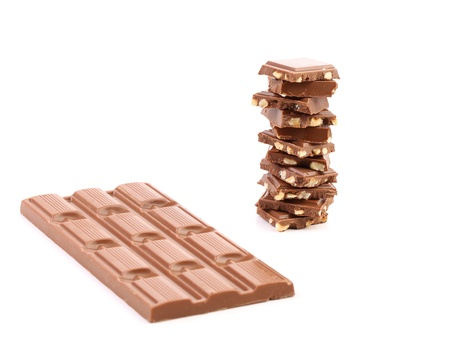 morsel: Tasty morsel of milk chocolate with nuts. White background.
