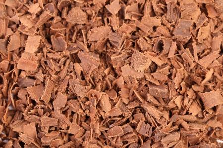Slices of chocolate. Close up. Whole background. photo