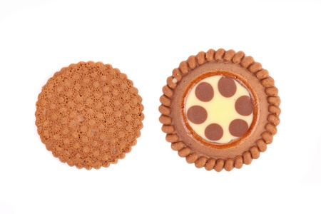 Brown chocolate biscuits with cream filling on a white background. photo