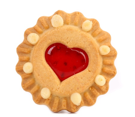 Heart shaped strawberry biscuit. Close up. White background. photo