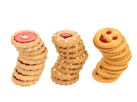 Three stacks of different biscuits  White background  Stock Photo - 21107218