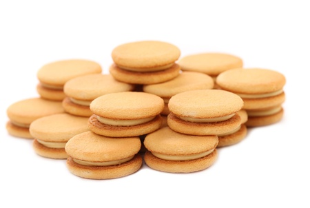 Biscuit sandwich with white filling. Close up. White background. photo