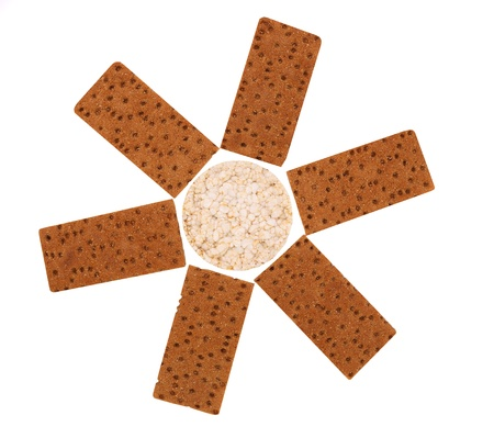 Composition of corn cracker and bread crisps. White background. photo