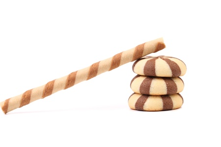 Striped chocolate wafer rolls and stake biscuits. White background.