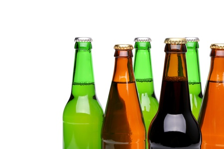Closed bottles of beer are located right on a white background photo