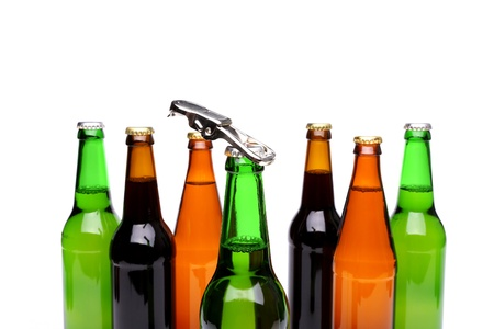 bottlenecks: Opener. Bottlenecks. Bottles of beer. Close up. White background.